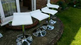 Four bar stools chrome legs and white leather seat tops