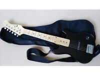 G10. Electric Guitar Outfit by Eleca. 1/2 size.