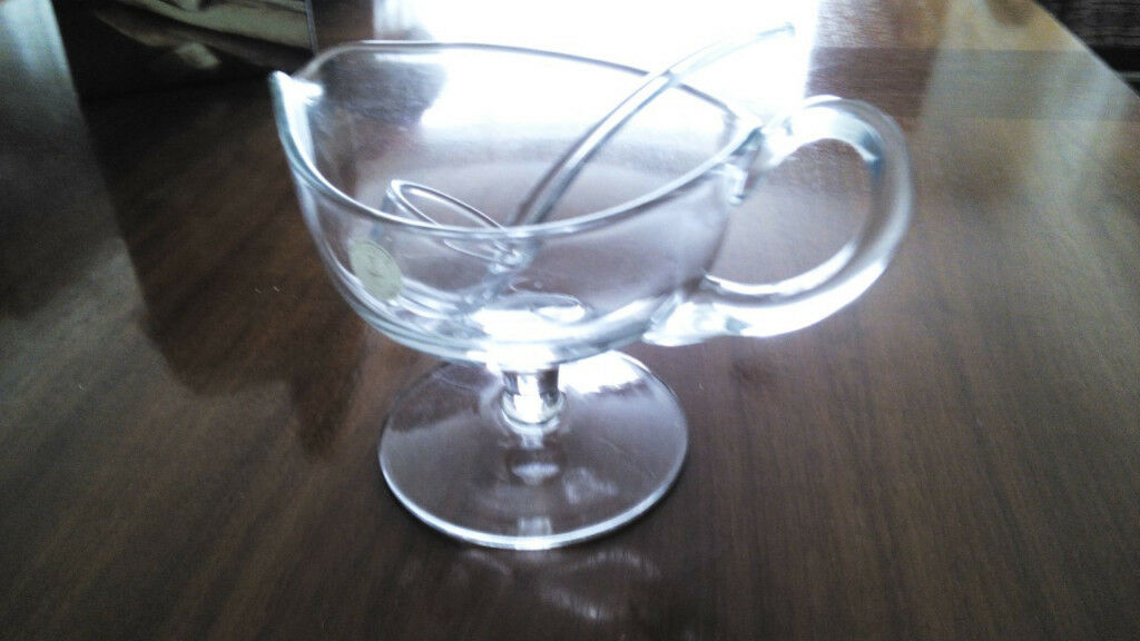 Unusual glass jug/sauce boat with serving ladle. Boxed and unused