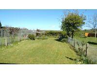 Gower 2-bed ground floor flat. Quiet village. Maintained garden. uPVC d-g. Fitted kitchen, bics