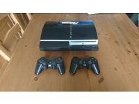PS3 250gb with 2 Controllers and 20 games.