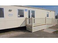 Sunnyvale Caravan Park,Kinmel Bay.Silver 2 bed wheel chair friendly unit. Price depends on date.