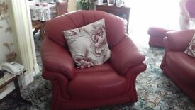 4 piece red leather suite. One recliner armchair. Storage poof