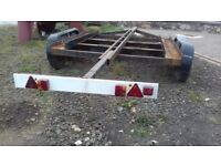 SOLD Twin axle trailer used for 26ft bilge keel boat..needs tlc ..two new tyres on rims