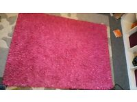 Bright pink shaggy rug roughly 5ftx4ft