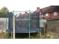 Trampoline with ladder and netting