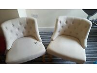 2x Cream Button back chairs- one is damaged
