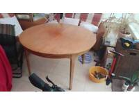Nathan round extending dining table