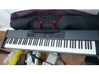 Roland RD-150 digital piano with stand