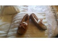 Ladies Ugg slippers size 6.5 will fit someone who takes a 5 or 6 worn once immaculate condition
