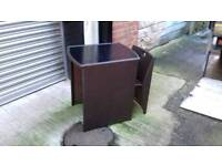 brown wicker glass top table and chair