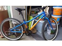 "Pinnacle Aspen 24"" blue and orange lightweight youth's bike."