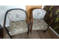 Pair of vintage chairs with a floral cloth pattern in good condition