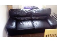 Free Black leather settee to anyone who can pick up.