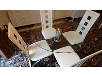 Glass dining table and 4 chairs for sale £100