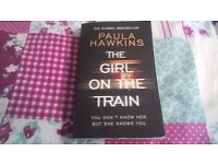 The girl on the train by paula hawkins paperback book read once.