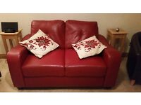 Deep red faux leather sofa