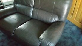 Two seater part leather reclineable sofa
