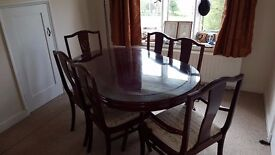 Bespoke single pedestal dining table and six chairs with fitted glass top accessory