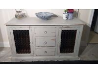 Beautiful cabinet painted in Anne Sloan Paris grey. Totally different with wrought iron doors.