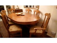 Large wood pedestal dining table, 6 chairs including 2 carvers, some restoration required