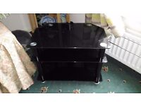 """Black glass tv unit would hold about up to 44"""" tv 3 tier also a cable tidy perfect condition"""
