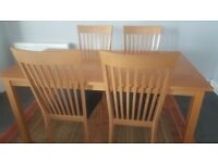Dining table, 4 chairs and sideboard.