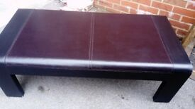 Lovely wood and leather finished coffee table can deliver