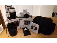 Samsung NX1100 digital camera. Also includes 20-50mm and 50-200mm lenses all boxed.