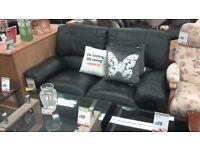 Black leather recliner sofa. BRITISH HEART FOUNDATION