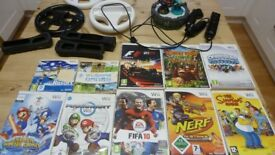 Nintendo wii bundle, includes games and accessories.