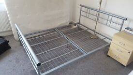 Double bed with a spring mattress