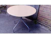 Round light oak look table with silver colured legs