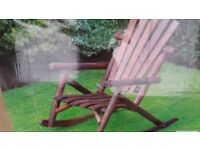 2 new boxed wagon wheel garden benches and new boxed garden rocking chair