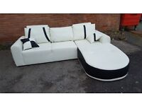 Fabulous 1 month old white and black leather corner sofa. clean and tidy. can deliver