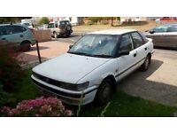 For sale: white Toyota Corolla Executive - 1.6L hatchback - 1991 - mileage 158k