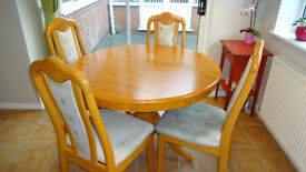Teak circular dining table and 4 chairs - excellent condition