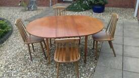 Extendable Table with chairs. .