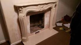 Marble hearth and matching back panel for fire.