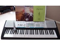 Casio LK-220 Personal Lighted Keyboard, 61-Key, with MP3 Connection, stand & music books