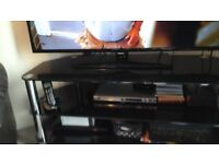 black glass corner tv stand in good condition for quick sale