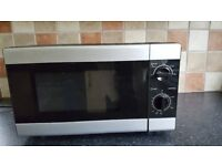 Black and silver microwave, excellent condition