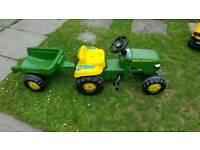 John Deere pedal tractor with trailer.