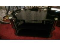 For sale black glass tv table
