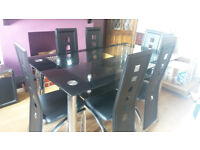 Black glass dining room table and 6 chairs