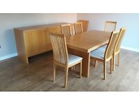 Dining table plus 6 chairs and a sideboard