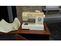 Singer 5910 sewing machine with cabinet table