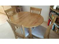 Extendable oak table and four chairs