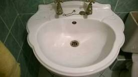 Antique basin with beautiful gold coated matching taps