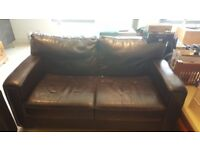 Dark Brown Two seater sofa for sale.